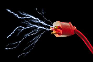 Red electrical plug with sparks flying out on large black background
