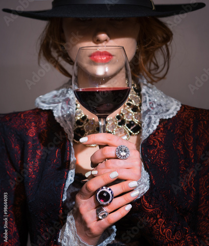 Wall mural A woman with a glass of red wine