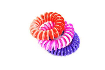 Spiral colorful elastic hair ties isolated on a white background