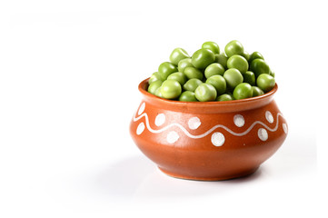 Fresh Green Peas in clay pot on white background