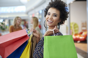 Happy woman with full shopping bags