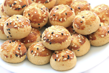 Sesame cookies on the plate .
