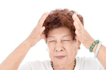 Asian Senior Thai woman having headace on white