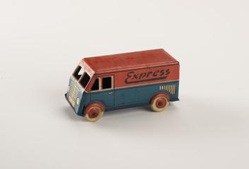 vintage tin car toy isolated on white