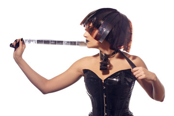Beautiful stylish woman in leather corset and filmstrips hairstyle posing isolated on white background