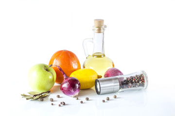 Olive oil, fruits, vegetables and spices on a white background