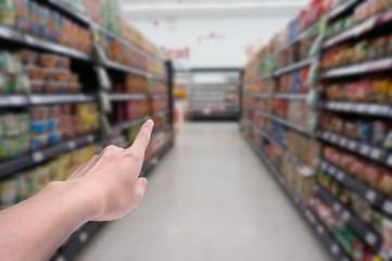 Blurred background,Supermarket shop blur background with finger point