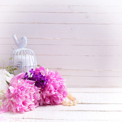 White and pink  peonies flowers on  white painted wooden planks.