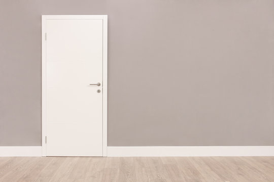 White door in an empty room