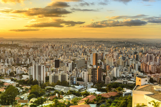 Panoramic view of golden  sunset in city  Belo Horizonte , Brazil .