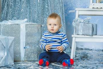 one years old child celebrating holidays near Christmas tree