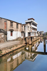 Row of traditional style houses reflected in a canal, Wenzhou, Zhejiang Province, China
