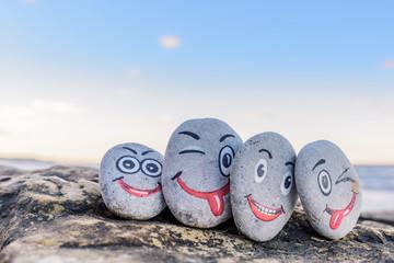 Emoticons on pebbles