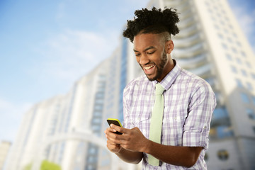 Young African American Man with his cell phone
