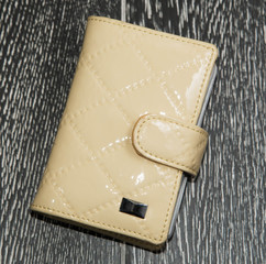 yellow card holder on dark background