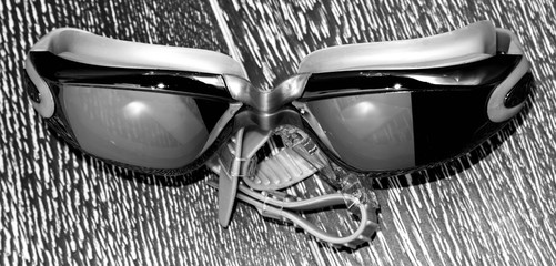 glasses for swimming isolated on dark