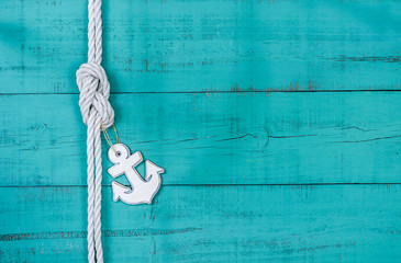Blank rustic teal blue sign with rope and anchor border