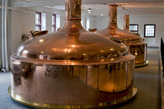 Copper distillery tanks in old brewery.