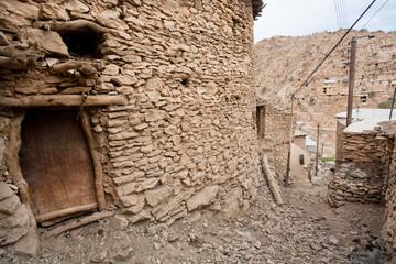 Village houses with brick walls and rural roads of Palangan, Iran.