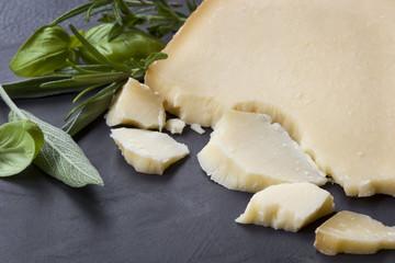 Gruyere Cheese with Herbs on Dark Slate