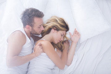 Male embracing his sleepy woman