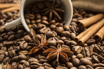 star anise and cinnamon on a background of coffee beans