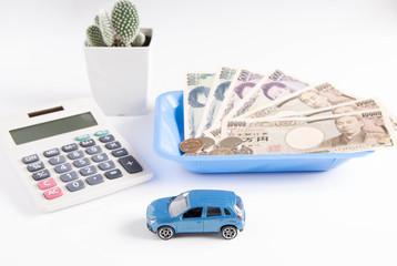 自動車とお金と電卓