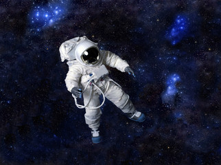 Astronaut floating in dark space.