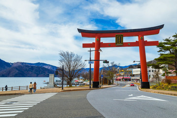 Massive torii gate of Futarasan shrine in front of lake Chuzenji in Nikko, Japan Wall mural