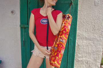 Girl with yoga mat bag