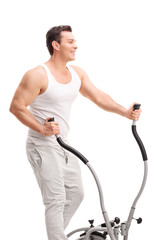 Young man exercising on a cross trainer