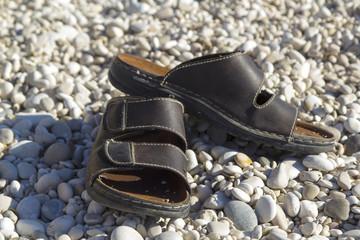 Flip flops on the beach stones