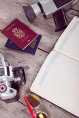camera, passport,glasses,on wooden table
