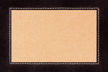 Frame of stitched brown suede on cardboard