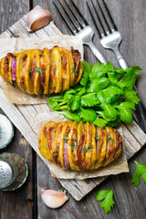Homemade baked potato with bacon and herbs