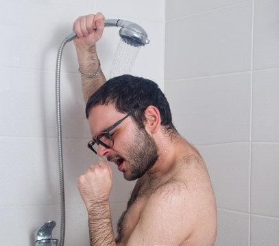 man sings in the shower