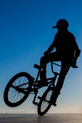 Stunt bicycle young man  silhouette