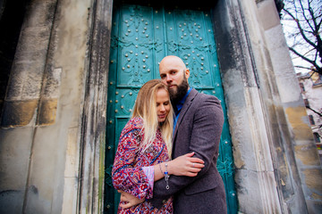 beautiful young couple in love, hugs, near the ancient building.