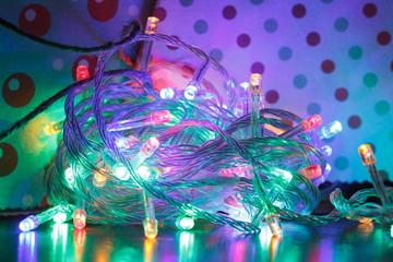 Tuinposter Imagination Christmas lights on dark blue background. Decorative garland
