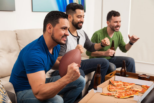 Friends watching american football