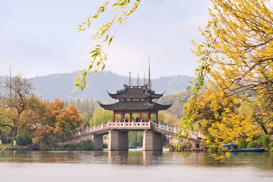 Famous bridge at enchanting West Lake in autumn colors, Hangzhou, China