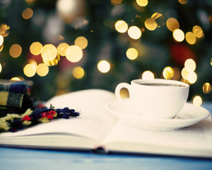 Coffee cup, scarf and book