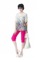 Full length fashion girl holding handbag posing in the studio