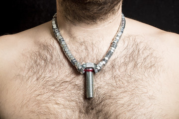 a male worker with a bare hairy-chested, wearing a necklace arou