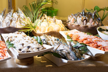 fresh seafood on table in cooking room