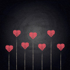 Drawing hearts on blackboard background