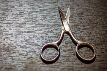 manicure scissors on a wooden board
