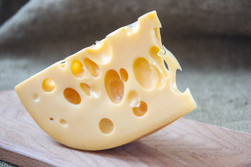 cheese on wooden cutting board