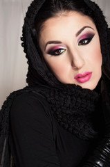 Beautiful Turkish woman with colorful Arabic make-up,  wearing a scarf on her head.