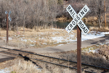 Rails crossing a paved trail in Durango, Colorado